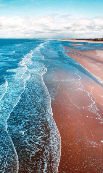 hình nền điện thoại bãi biển và những con sóng trắng