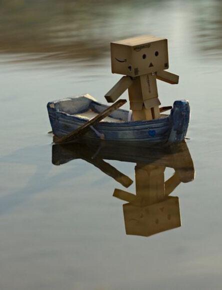 ảnh người gỗ bơi thuyền trên sông