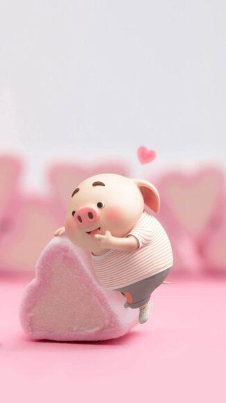 Hình ảnh con lợn với viên kẹo hồng